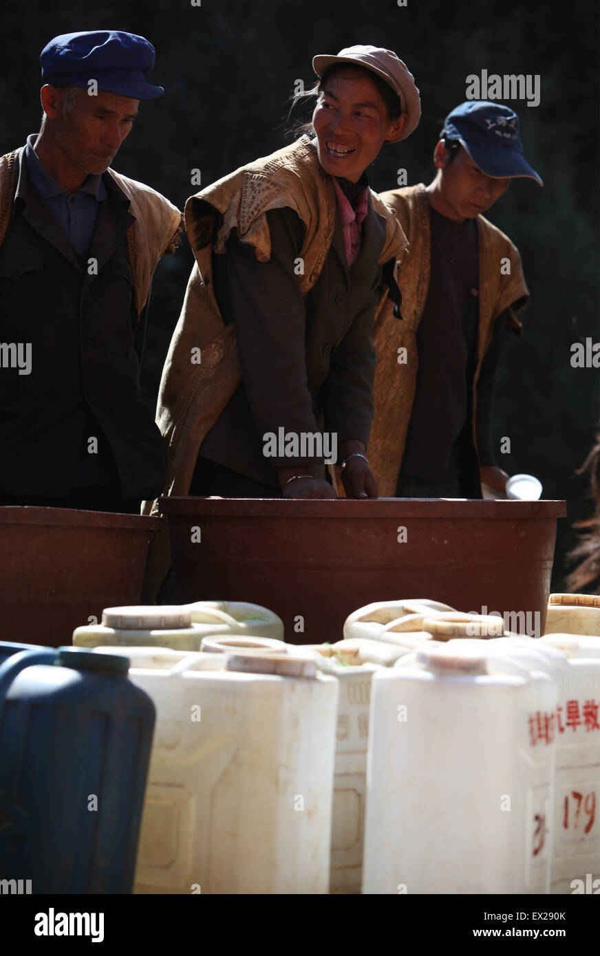 Locals wait to get water delivered by the soldiers of People's Liberation Army at a drought-hit village in Luquan, - Stock Image