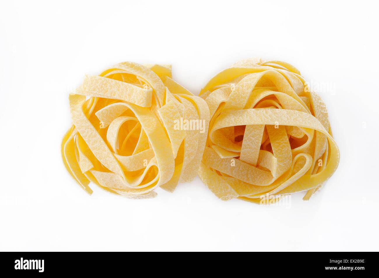egg fettuccine pasta on white background - Stock Image