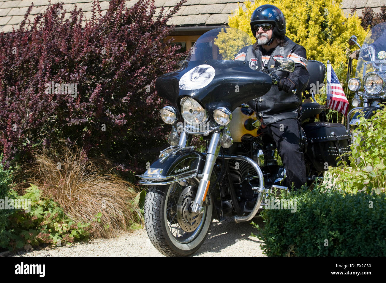 Biker on his Harley Davidson motorcycle - Stock Image