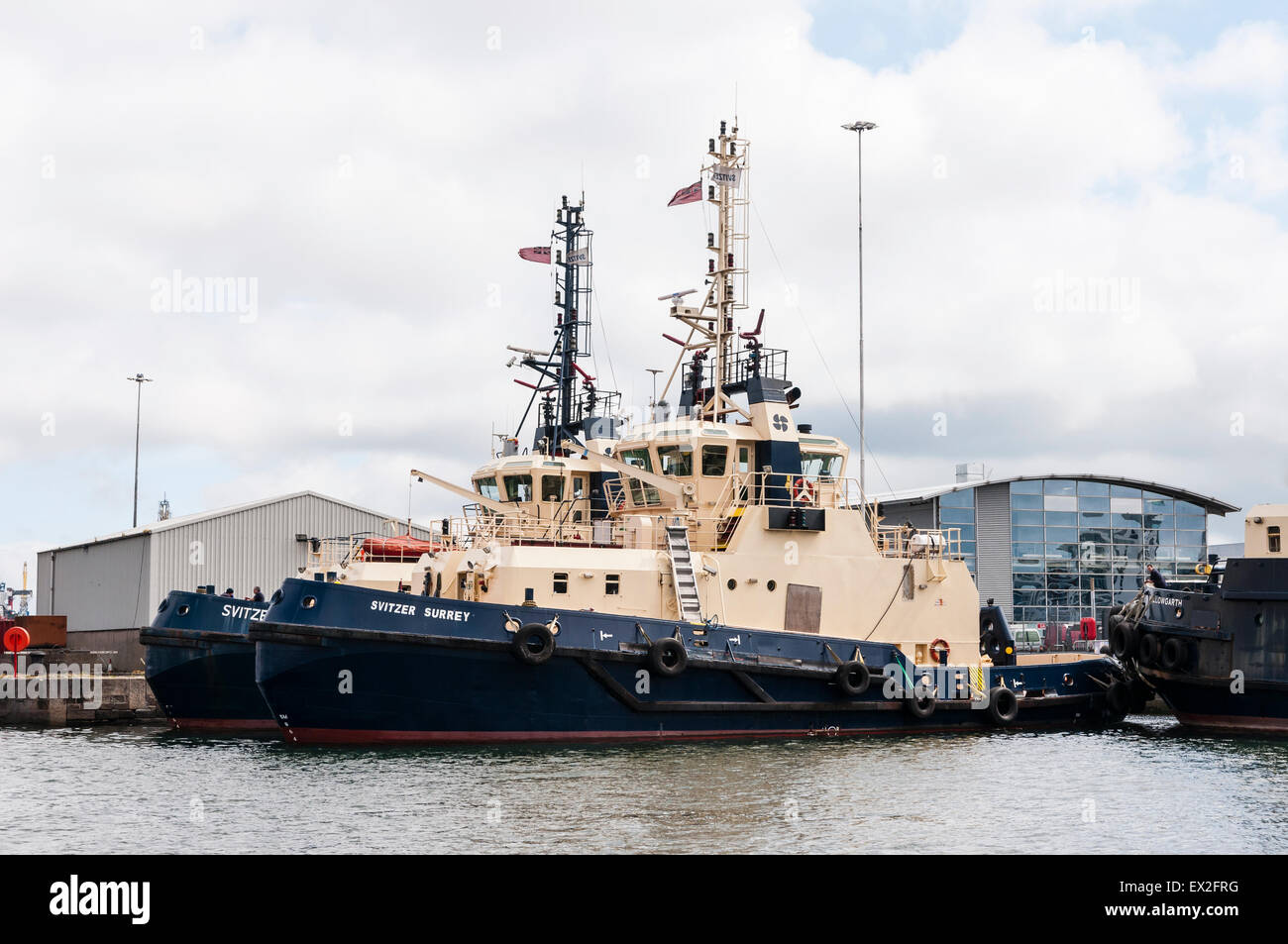 Belfast harbour tug boats, the Svitzer Surrey, and Svitzer Sussex - Stock Image