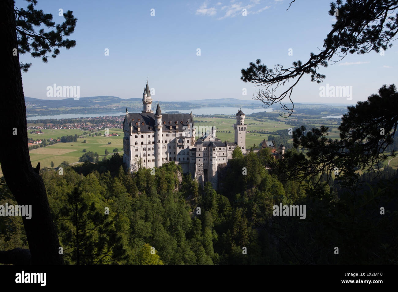Neuschwanstein Castle is a 19th-century Romanesque Revival palace on a rugged hill above the village of Hohenschwangau - Stock Image