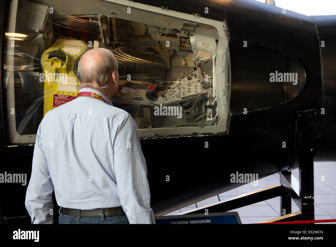 Visitor views a Gemini space capsule at Davidson Center for Space Exploration, Huntsville, AL - Stock Image