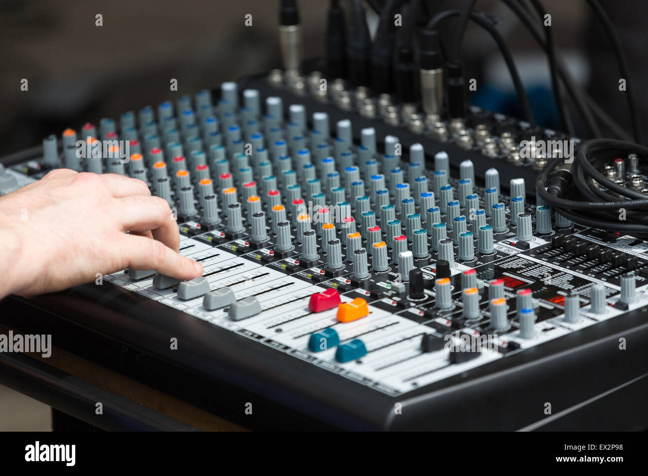 A sound mixing board at a music gig - Stock Image