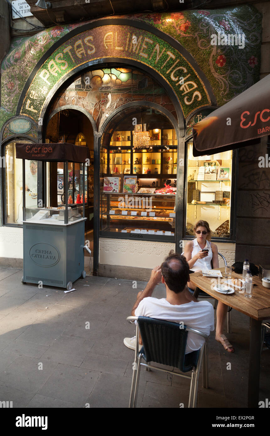 People eating outside at the Escriba pastry shop cafe on Las Ramblas, Barcelona, Spain Europe - Stock Image