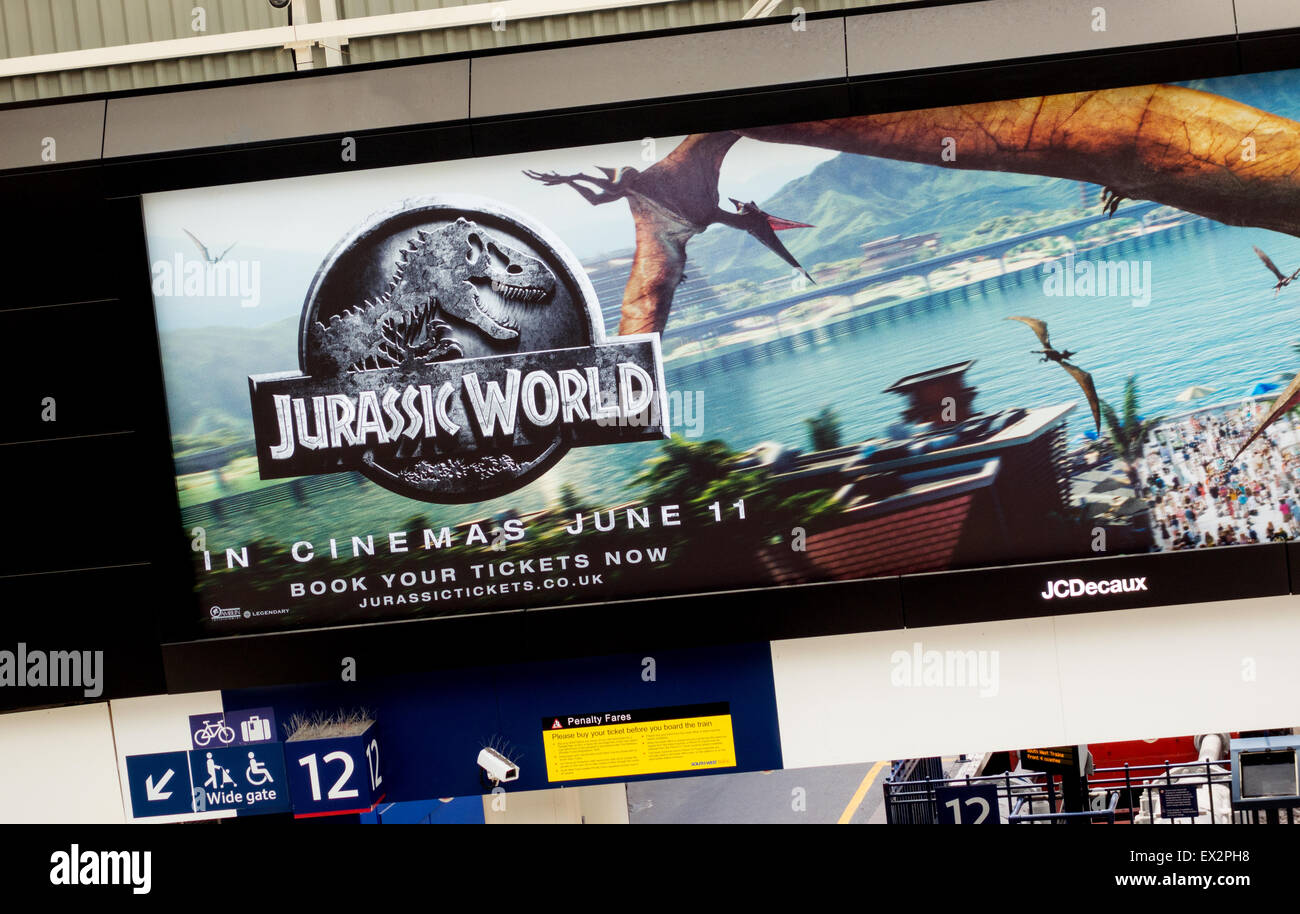 An advertising billboard poster for the film Jurassic World, Waterloo station, London UK - Stock Image