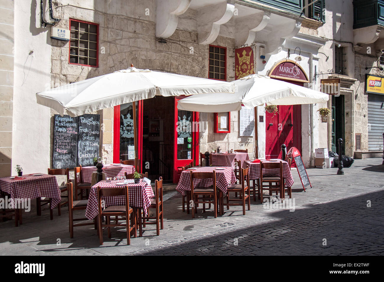 A cafe bar in  a shady street in Valletta, Malta - Stock Image