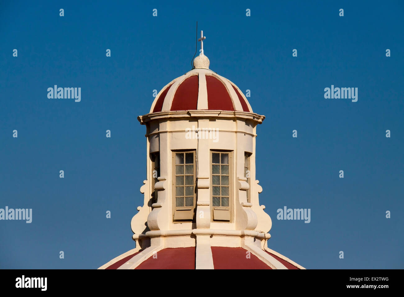 A bright church cupola against a bright blue sky - Stock Image