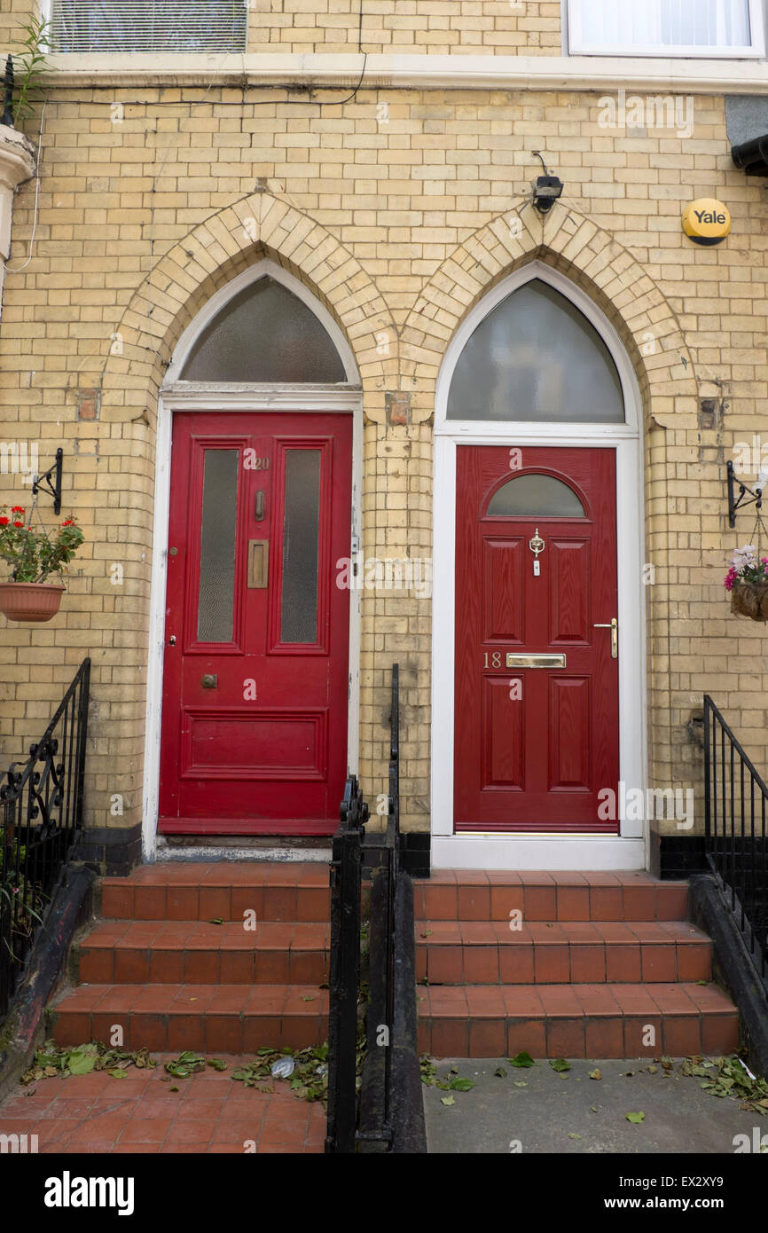 Two Red Front Doors Arched Church Like Elegant - Stock Image