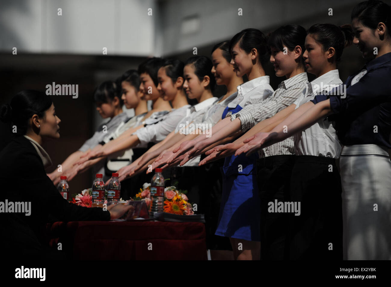 Candidates attend an etiquette test during a job fair recruiting the airline attendants for the 2010 Guangzhou Asian Stock Photo