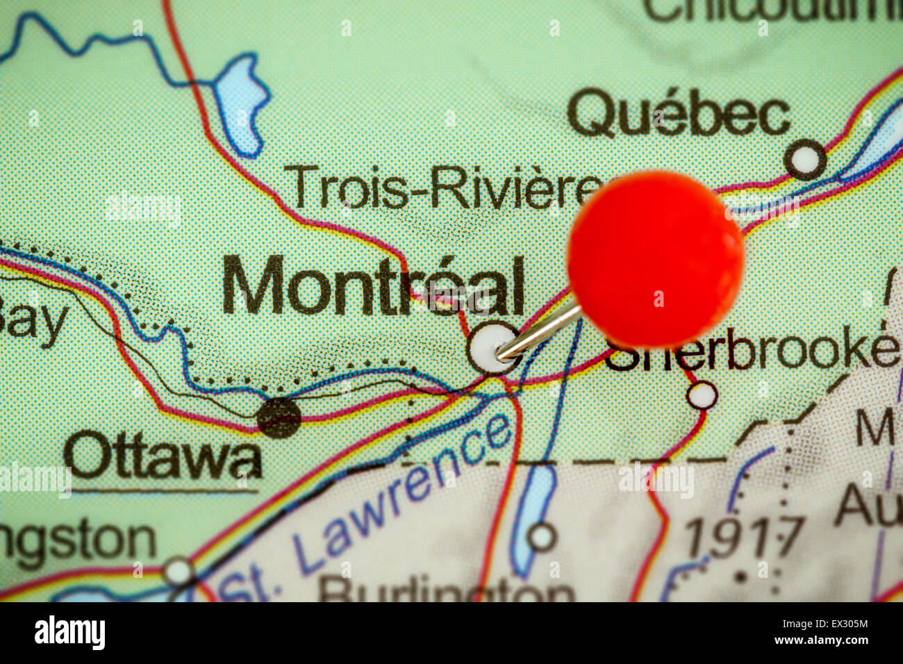 Canada Map Montreal.Close Up Of A Red Pushpin On A Map Of Montreal Canada Stock Photo