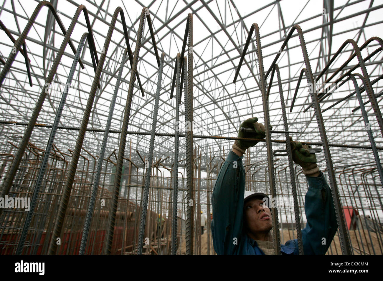 A migrant worker works at a construction in Taiyuan, Shanxi province March 30, 2010.  VCP - Stock Image