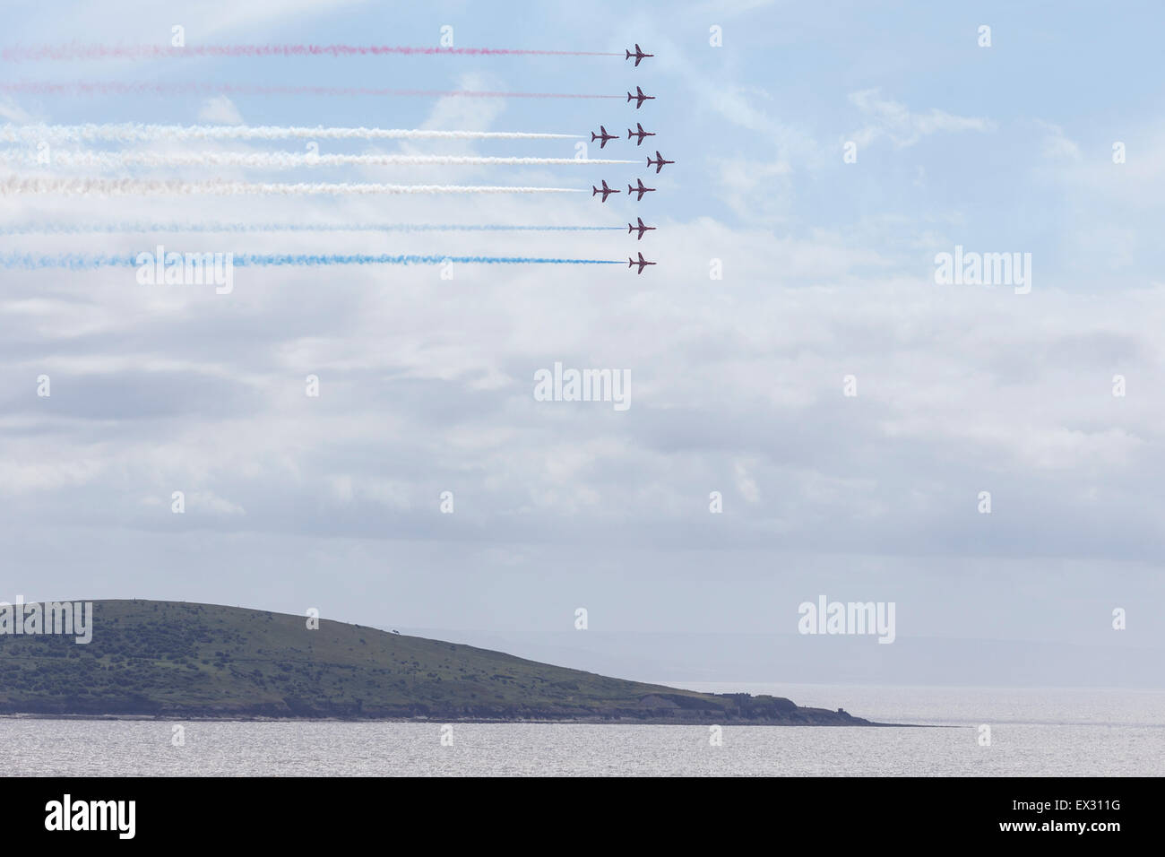 RAF Red Arrows aerobatic display team in formation above Brean Down - Stock Image