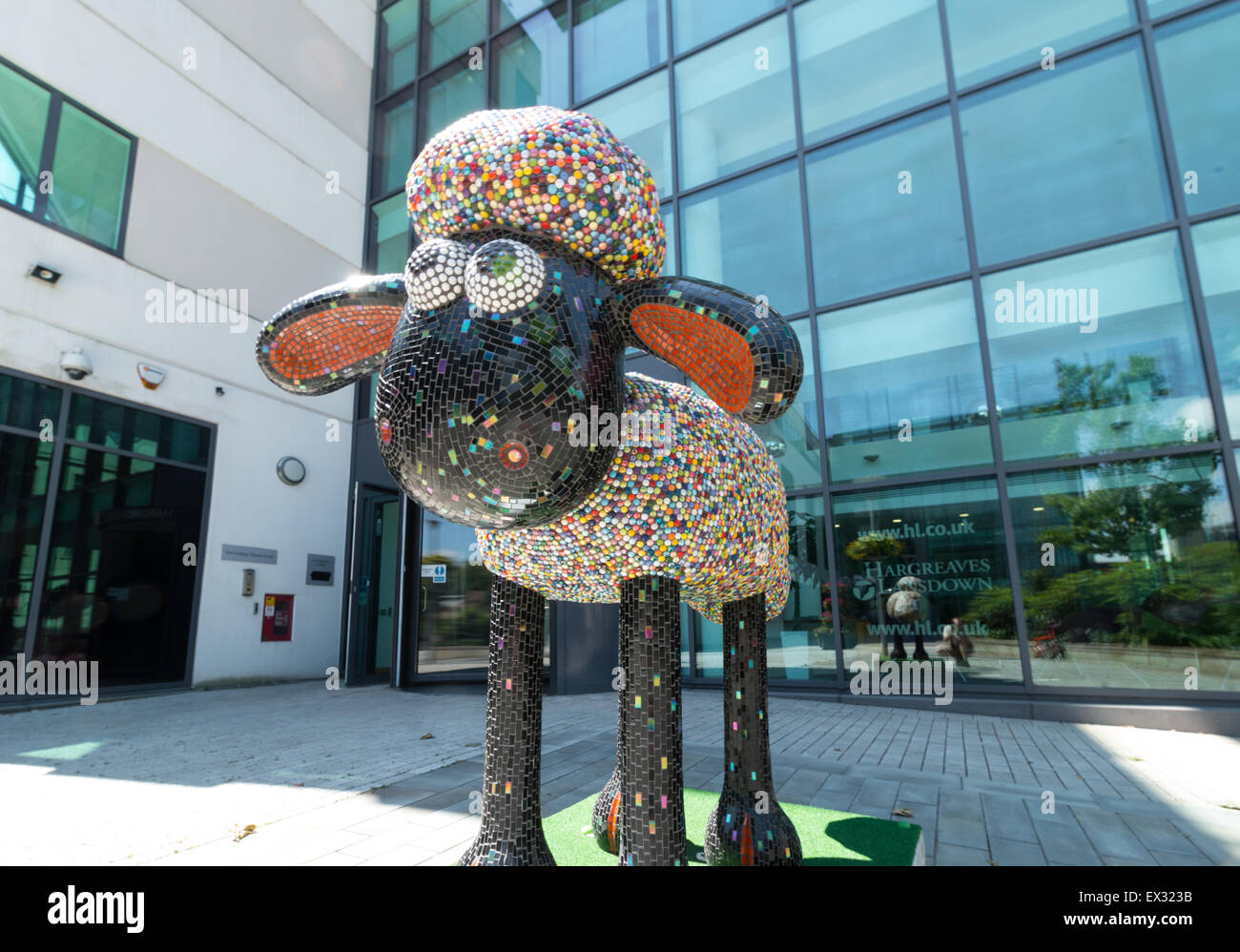 DOLLY by Julie Vernon outside Hardgreaves Lansdown in Bristol. Part of the Shaun the Sheep Art Trail across Bristol - Stock Image