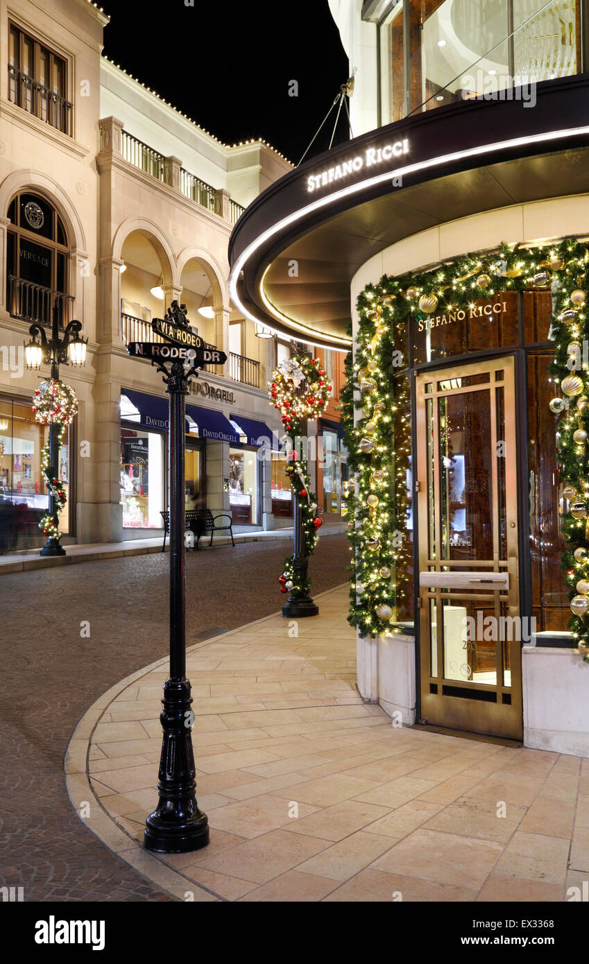 Luxury shops and boutiques on via Rodeo and Rodeo drive, Beverly Hills. Christmas decorations at night. - Stock Image
