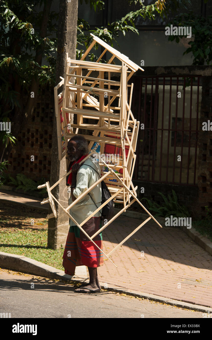 Fantastic A Deck Chair Hawker Carrying A Stack Of Folding Chairs Along Evergreenethics Interior Chair Design Evergreenethicsorg