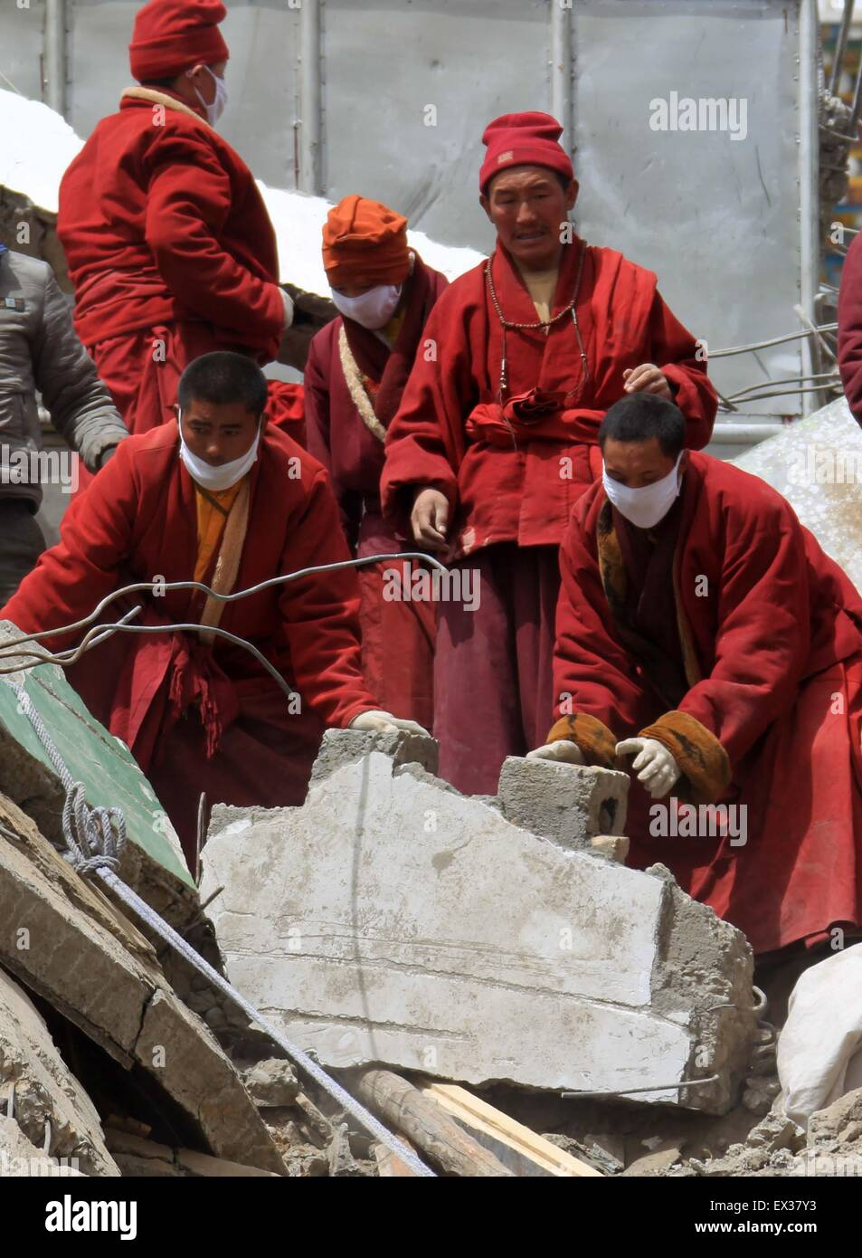 Tibetan monks search for survivors in the earthquake-hit town of Gyegu in Yushu County, Qinghai province, April - Stock Image
