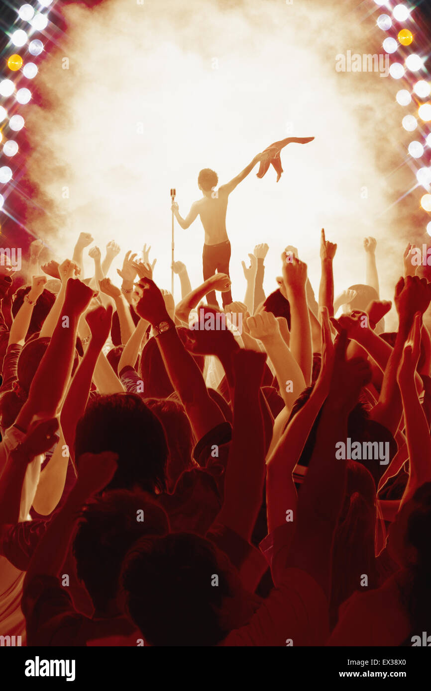 Audience enjoying live concert - Stock Image