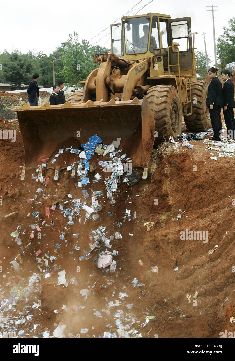 Customs officers  destroyed counterfeit branded goods at a rubbish dump site in Kunming, Yunnan province April 26, - Stock Image