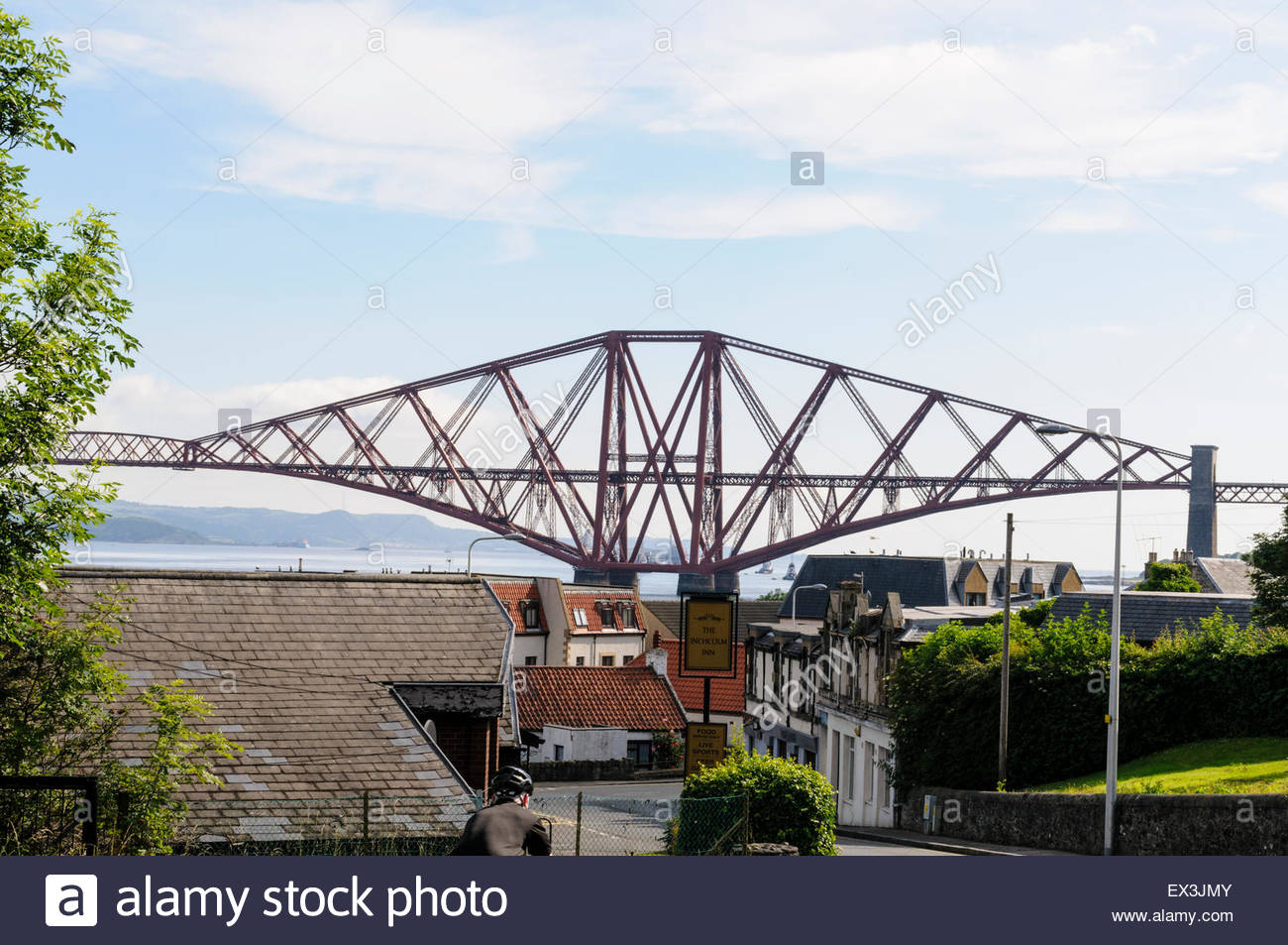South Queensferry, UK. July 6, 2015. Forth Bridge dominates the view east from South Queensferry. The Forth Bridge - Stock Image