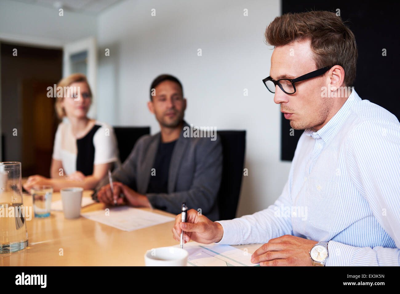 White male executive talking during meeting in conference room - Stock Image