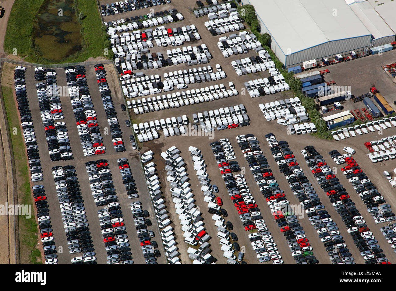 aerial view of parked cars & vans outside a factory in Stoke on Trent, UK - Stock Image