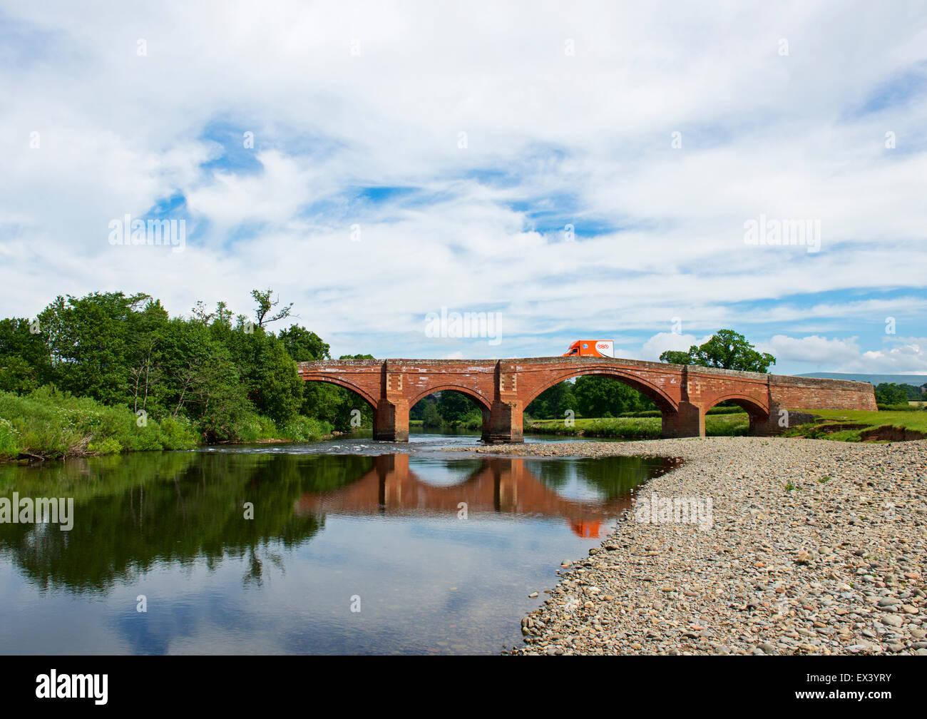 TNT delivery van on bridge over the River Eden near Lazonby, Eden Valley, Cumbria, England UK - Stock Image