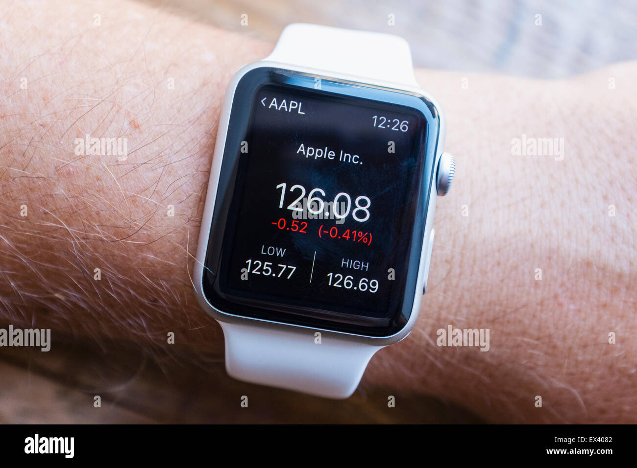Stock price of Apple company showing on an Apple Watch - Stock Image