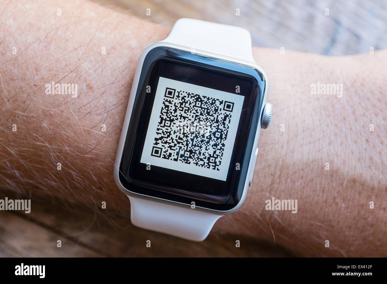 Airline passenger boarding pass barcode on an Apple Watch - Stock Image