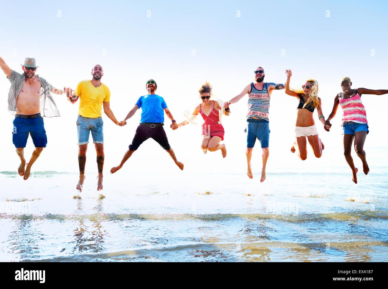 Diverse Beach Summer Friends Fun Jump Shot Concept - Stock Image