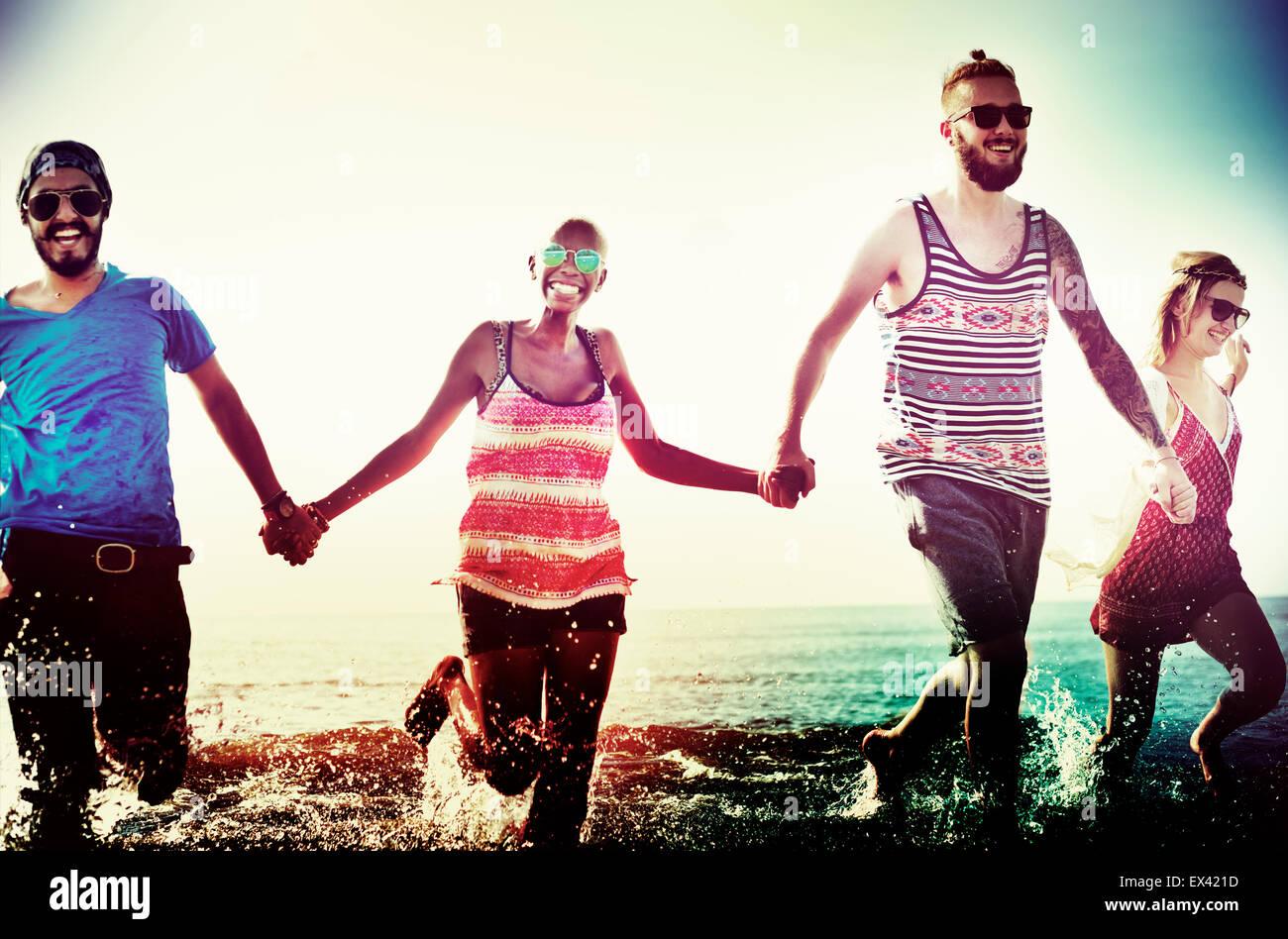 Diverse Beach Summer Friends Fun Running Concept - Stock Image