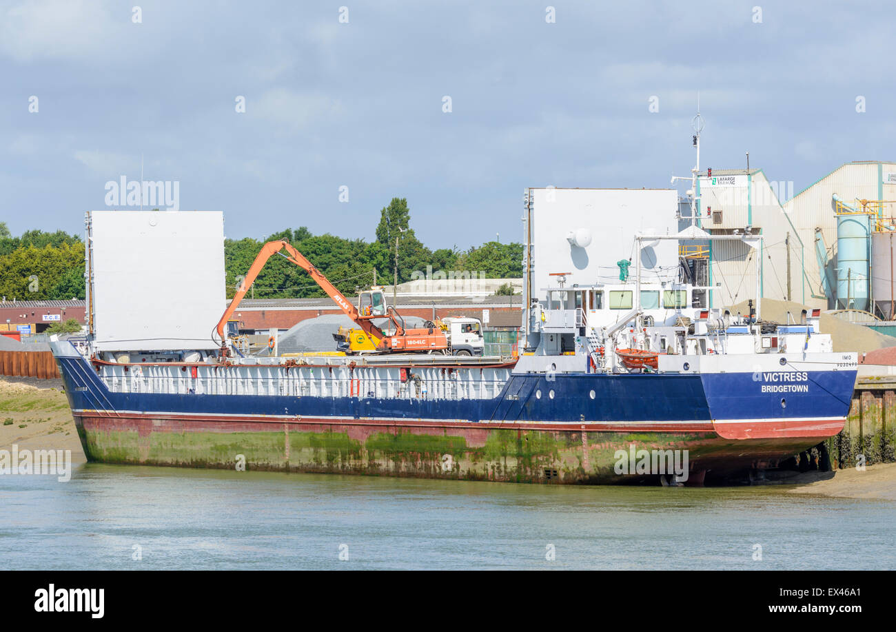 "The cargo ship ""Victress"" in port on a river being unloaded. Stock Photo"
