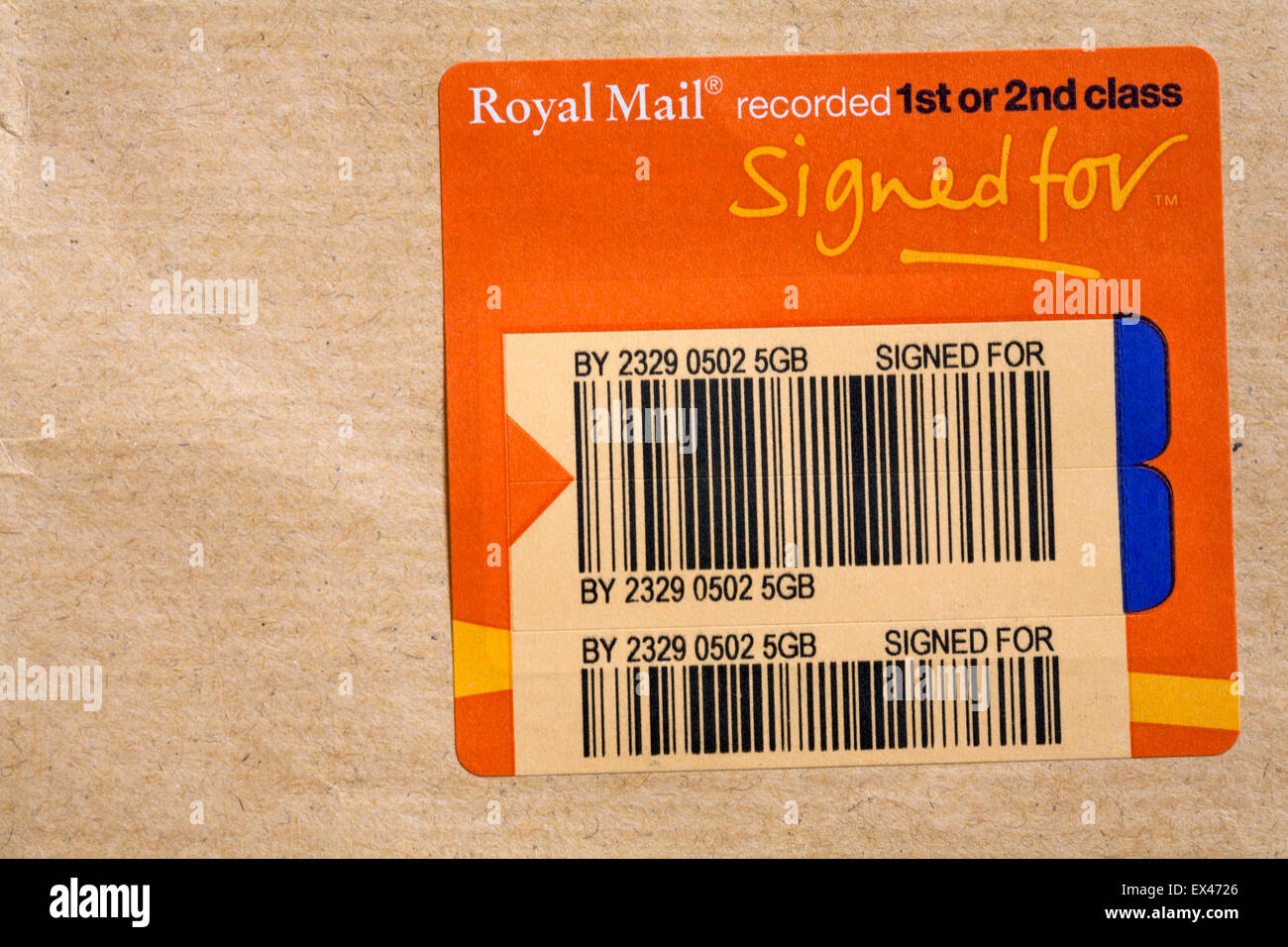 Royal Mail recorded label on brown envelope - Stock Image