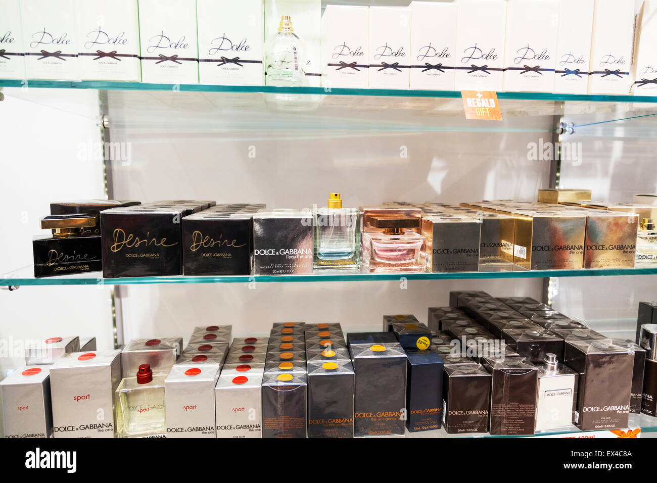 Dolce and Gabbana fragrances perfumes perfume display ladies Eau De Toilette aftershave for men shop store - Stock Image