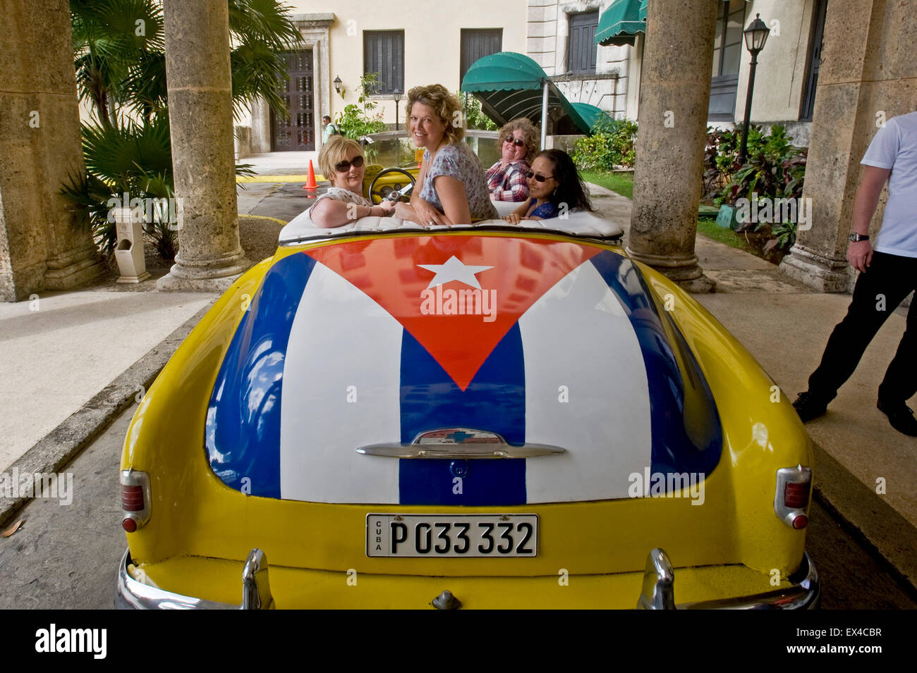 Horizontal view of a yellow Chevrolet cabriolet at the entrance of the Hotel Nacional de Cuba in Havana. - Stock Image
