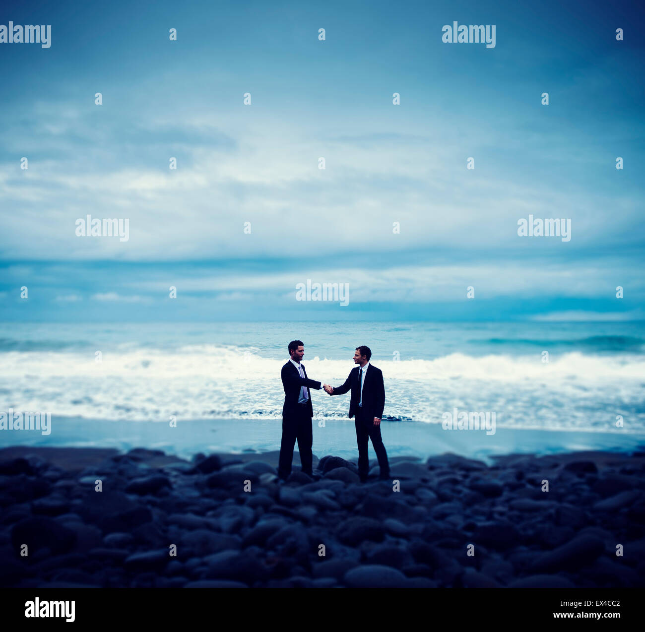 Businessmen Commitment Handshake Beach Relaxatiion Concept - Stock Image
