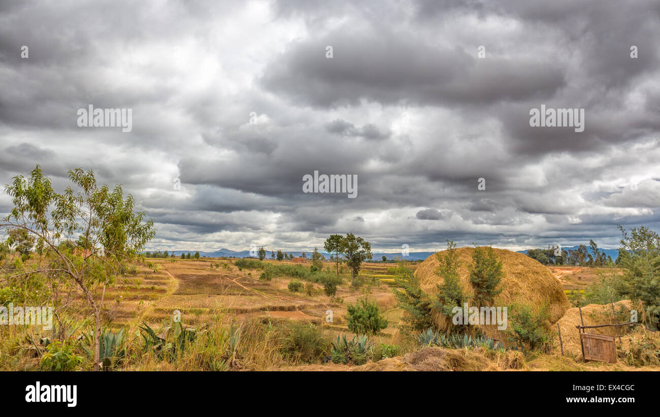 Dark clouds hovering over the farm lands of the highland areas of Madagascar - Stock Image
