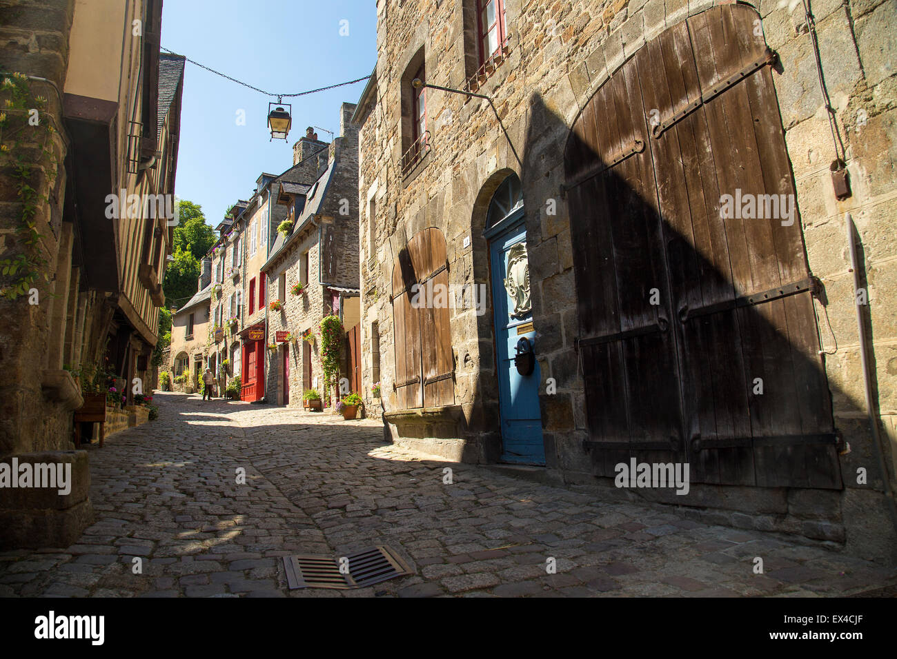 Street in Dinan Northern Brittany cobbles and old wooden doors Stock Photo