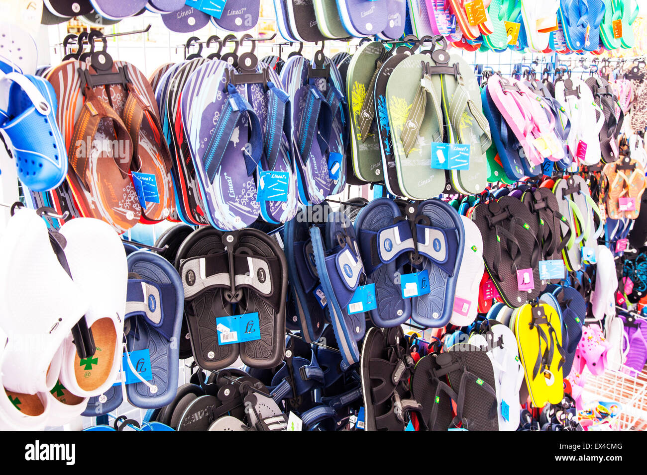 Flip flops footwear summer shoes shop display stand store - Stock Image