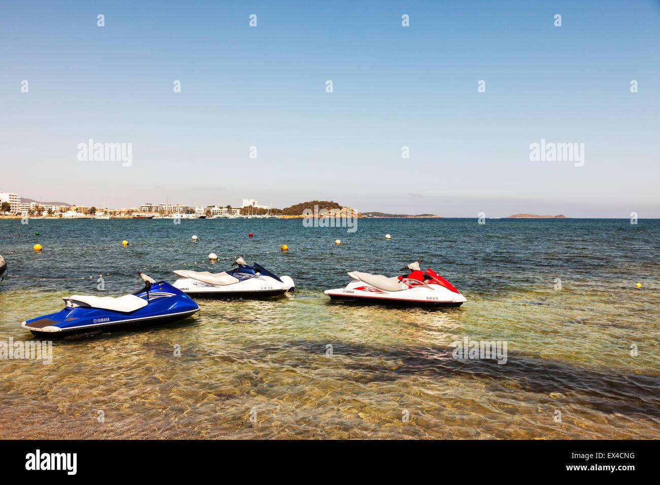 Jet ski machines jetski skies sea water sport sports watersport watersports - Stock Image