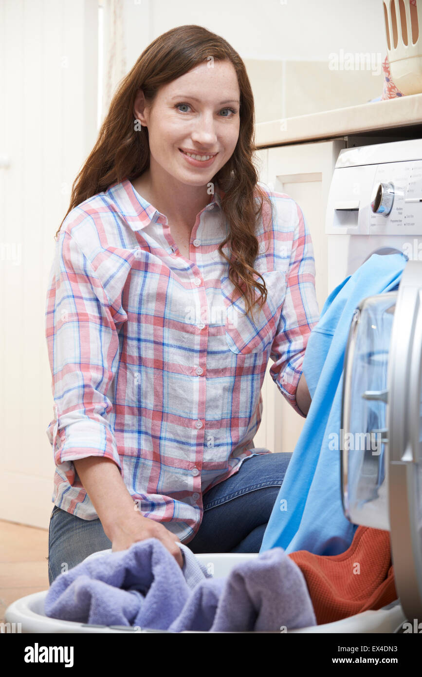 Portrait Of Woman Doing Laundry At Home - Stock Image