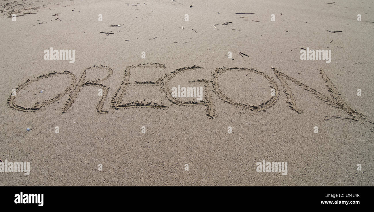 the word Oregon written in the sand - Stock Image