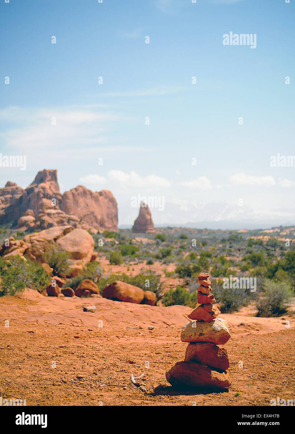 A trail marking cairn is often a welcome sight in the Utah desert, Arches National Park, Utah. - Stock Image