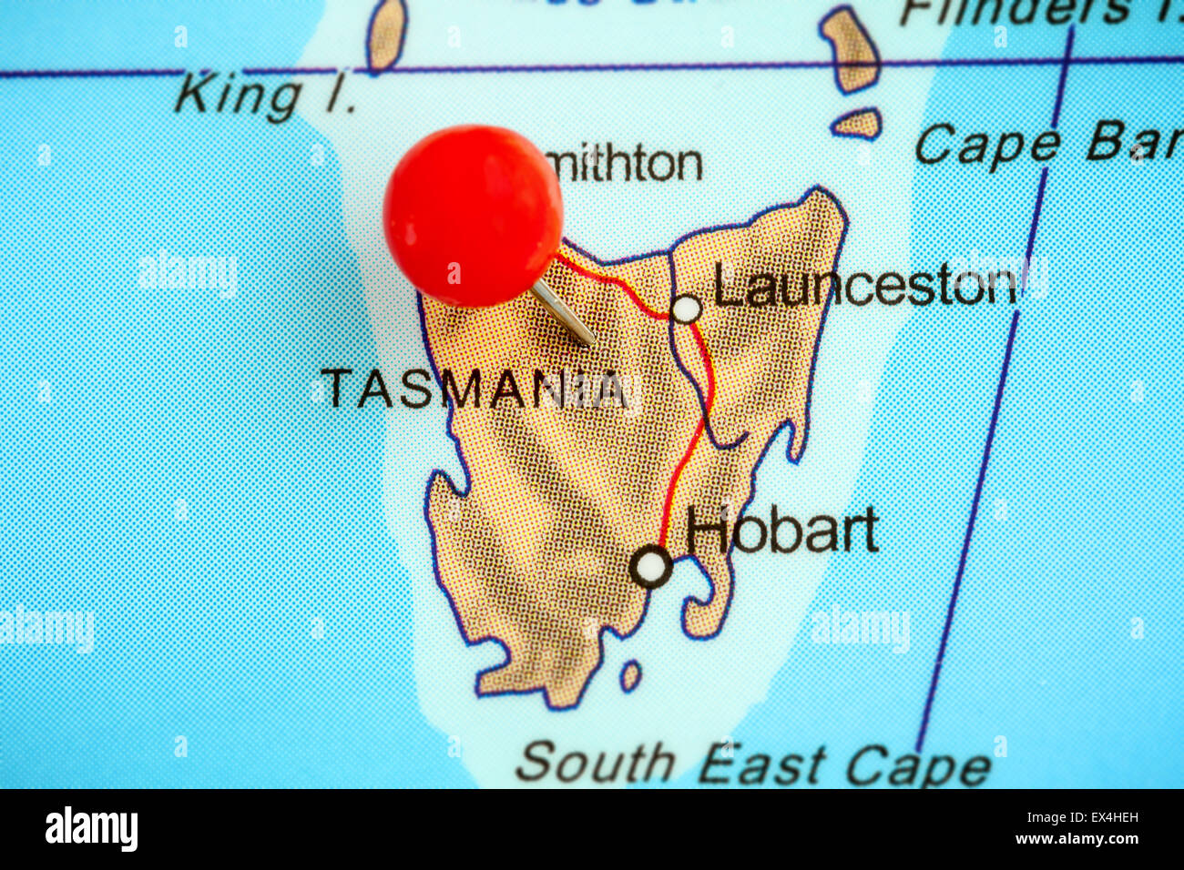 close up of a red pushpin on a map of tasmania australia