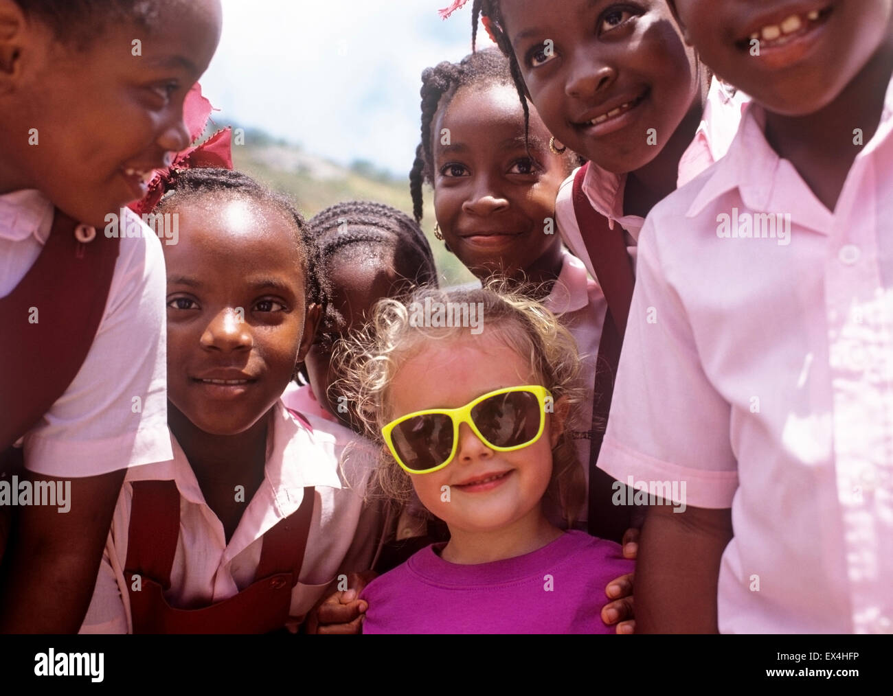 North America Caribbean British Virgin Islands Tortola Caucasian tourist meets African American school children - Stock Image