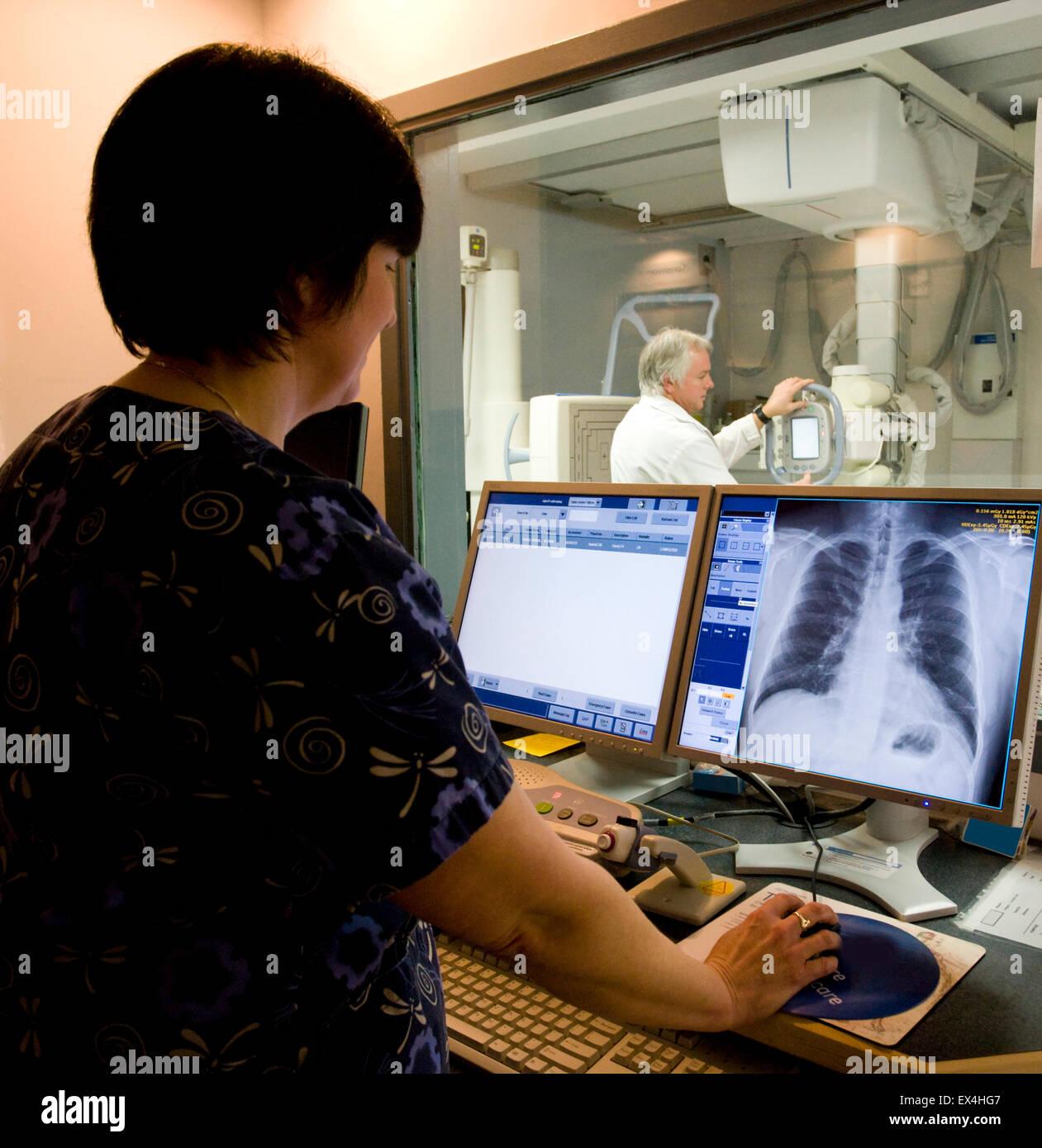 radiologist with digital X Ray machine - Stock Image