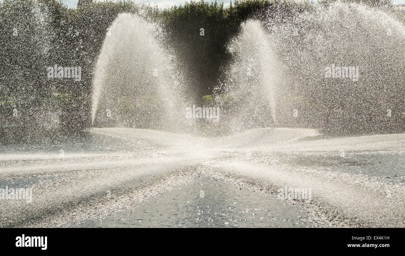 High pressured water gushing out of a pipes creating a beautiful water fountain - Stock Image