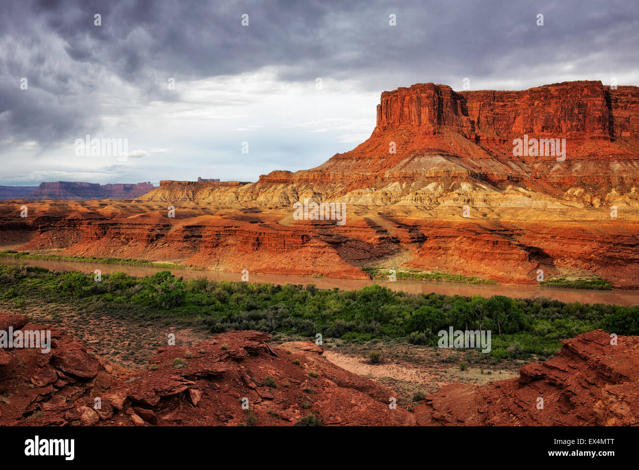 Morning light on the Green River at remote Fort Bottom with an approaching thunderstorm in Utah's Canyonlands National - Stock Image