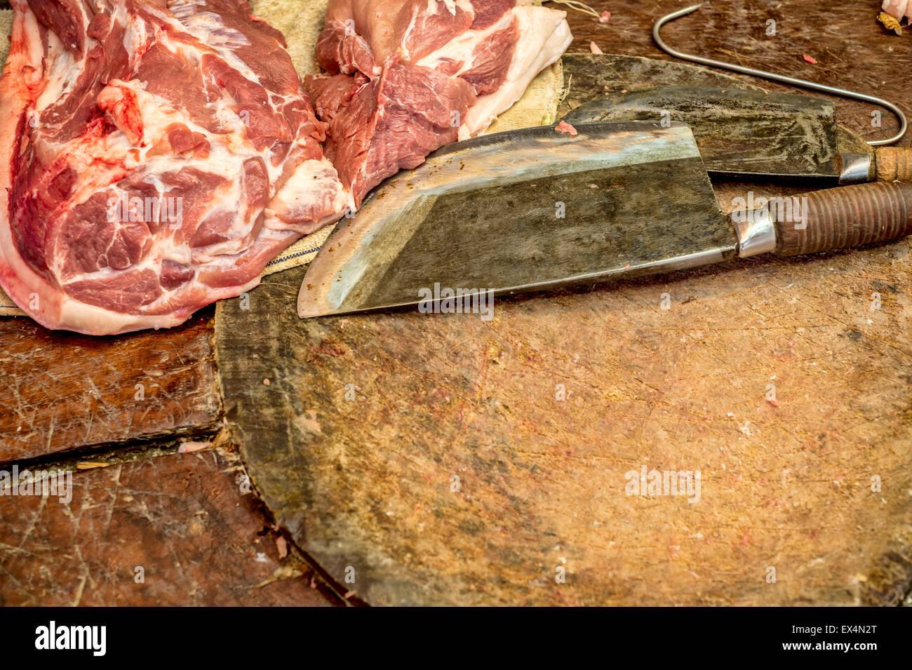 Butcher knife on cutting board Stock Photo