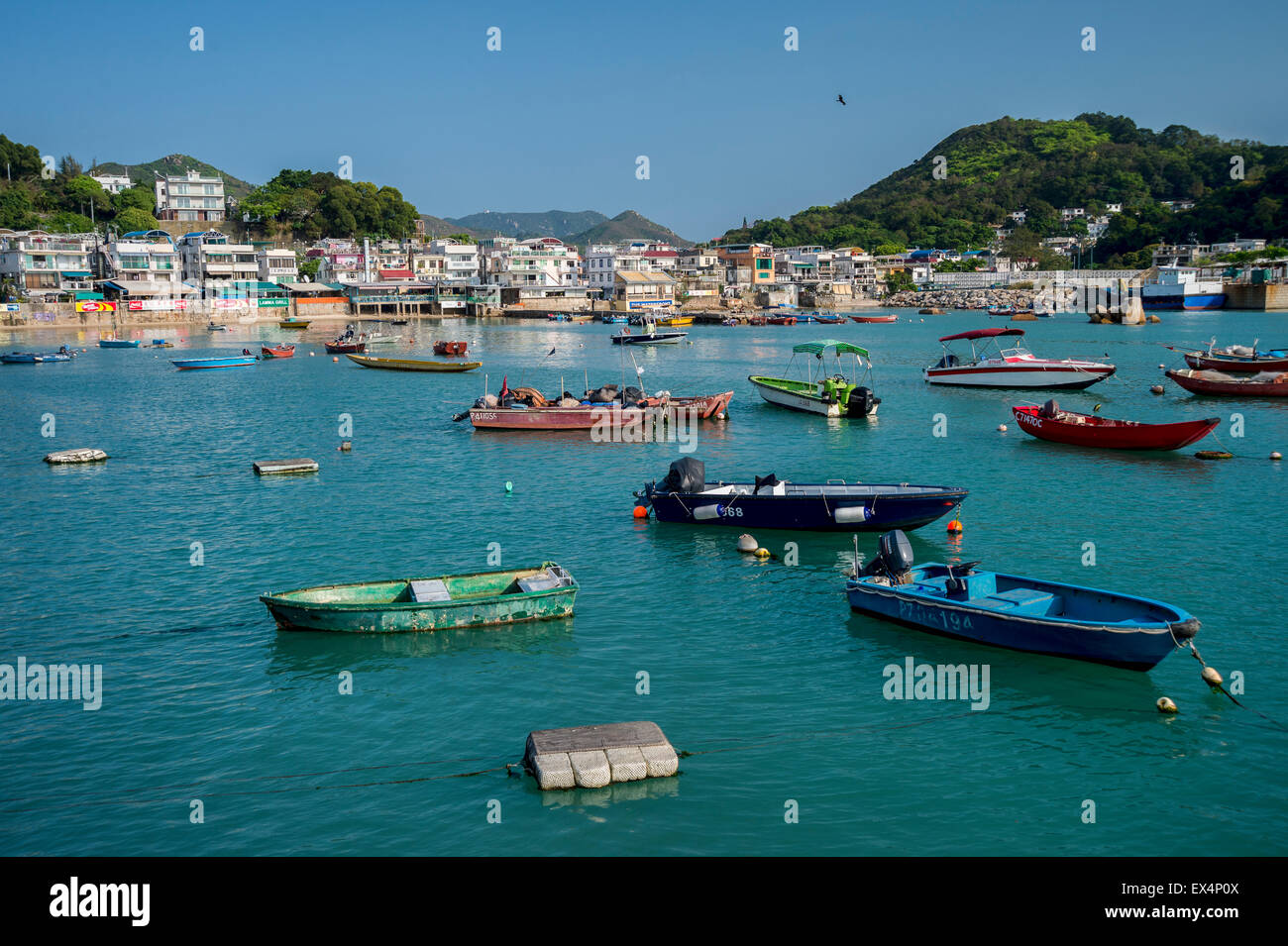 Harbour and boats in Yung Shue Wan on Lamma Island, Hong Kong - Stock Image
