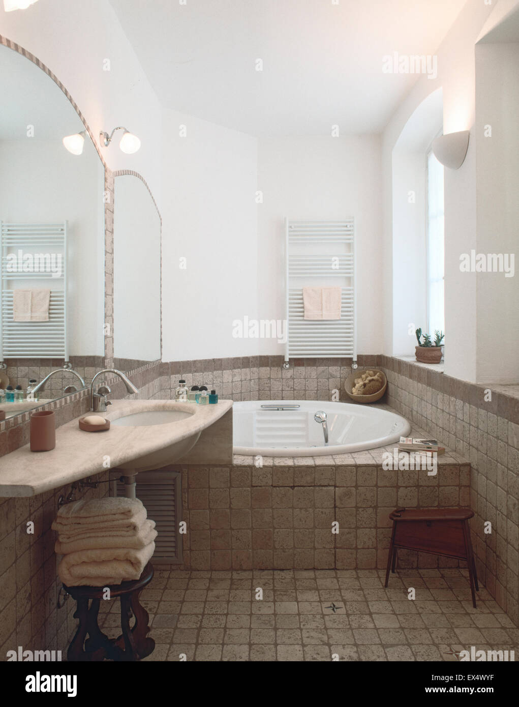 interior view of classic bathroom with tile floor overlooking on bathtub - Stock Image